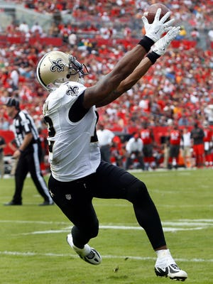 New Orleans Saints wide receiver Marques Colston (12) catches a 1-yard touchdown reception against the Tampa Bay Buccaneers during the second quarter of an NFL football game Sunday in Tampa, Fla.