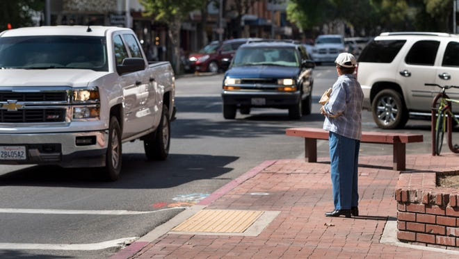 Some pedestrian crossings on Main Street in Downtown Visalia are marked for new signage to alert motorists of crossings between traffic lights and stop signs.
