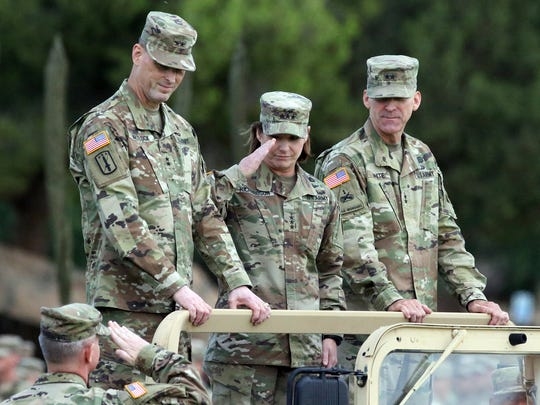 "Lt. Gen. Laura J. Richardson, center, returns a salute to Col. John M. Cushing, bottom, as Maj. Gen. Patrick E. Matlock, left, and Maj. Gen. Robert ""Pat"" White watch Thursday at Fort Bliss. Matlock succeeds White as commander of the 1st Armored Division and Fort Bliss."