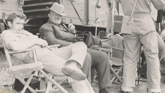 Burl Ives and James Dean relax between scenes during the filming 'East of Eden' in Salinas, California, 1954