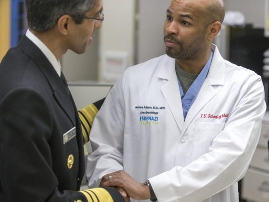 Indiana Health Commissioner Dr. Jerome Adams (right)