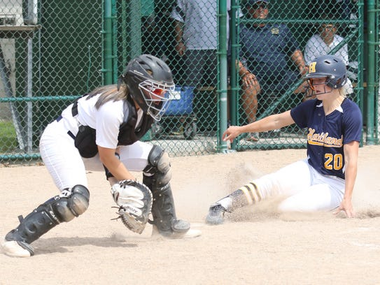 Anna Kemp of Hartland slides home with the tying run