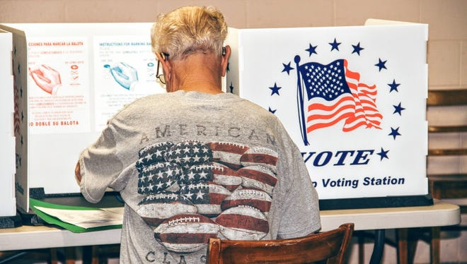An Otero County resident votes at the Otero County Fairgrounds, 401 Fairgrounds Road, Friday afternoon.