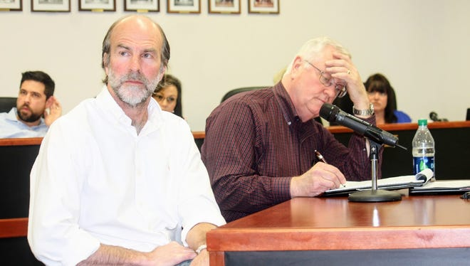 Program Manager and Senior Geologist Peter Gram, left, and TerranearPMC C.E.O. Kenneth T. Fillman, right, discuss the Salt Basin Deep Borehole Research Project at the Feb. 9 regular county commission meeting.