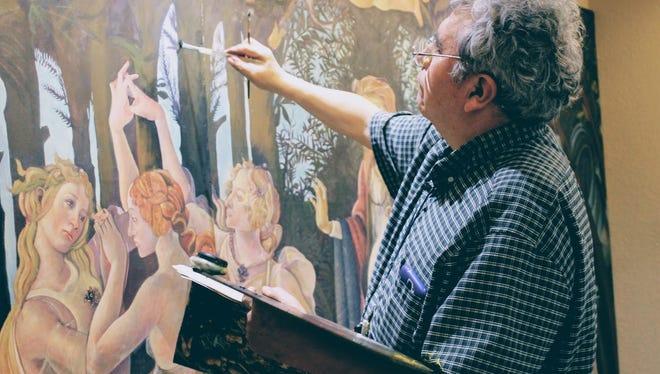 Tularosa painter Luis Orozco paints La Primavera, a Renaissance piece by Sandro Botticelli at First National Bank, 414 E. 10th St. Wednesday.