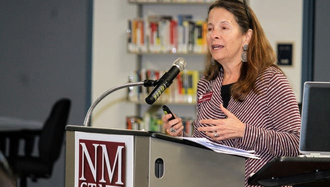 New Mexico State University regent Jerean Hutchinson goes over key points and criteria on regarding university's search for a new chancellor at NMSU-Alamogordo Tuesday night.