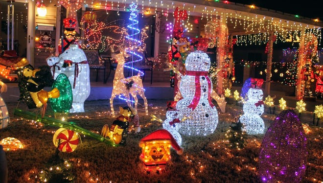 The Alamogordo Fire Department is offering tips for a safe, fire-free holiday season. If hanging lights outside the home, such as those shown in this Daily News file photo, make sure the lights are rated for outdoor use.