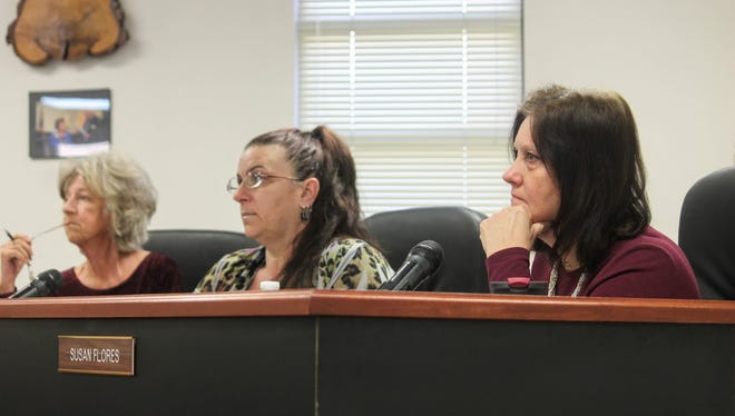 County Commissioners listen to comments regarding right-to-work laws at their regular meeting Thursday, Feb. 8.