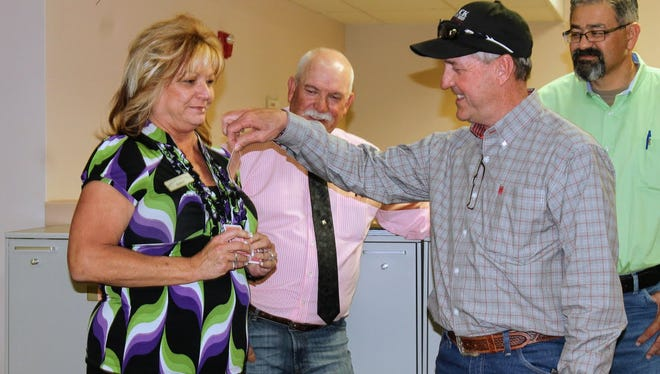Otero County Sheriff candidate David Black draws for a position on the ballot from Otero County Clerk Robyn Holmes Tuesday evening at the Otero County Clerk's Office.