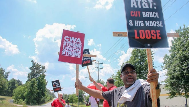 "Nathaniel Myers, AT&T distribution center coordinator, chants, ""Cut Bruce and his Noose Loose"" with other protesters Friday outside the AT&T Distribution Center. Myers said he watched a video of the scene where employees contend a manager tied a rope into a noose after a work stoppage on Sept. 17, 2017."