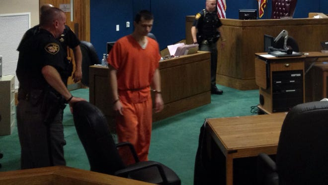 Deputies lead Austin Myers into his sentencing hearing in Warren County Common Pleas Court on Thursday, Oct. 16, 2014.