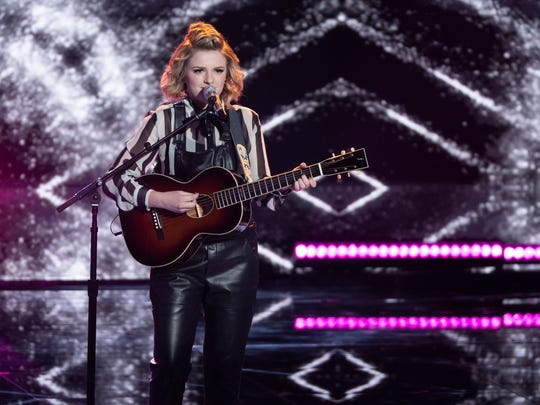 Maddie Poppe of Clarksville, Iowa, sings during the performance finals for ABC's American Idol.