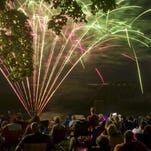 DENNY SIMMONS / THE GLEANER Fireworks light up the sky over the Ohio River as spectators take in the 4th of July show at Audubon Park Monday night.