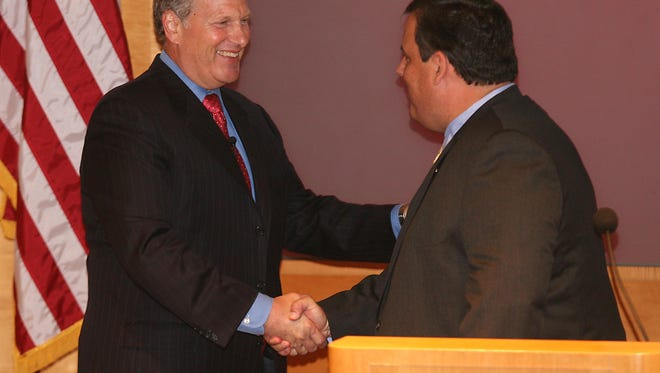 David M. Cote (left), CEO of Morristown-based Honeywell International seen in this 2010 file photo with Gov. Chris Christie, had compensation worth $34.5 million in 2015.