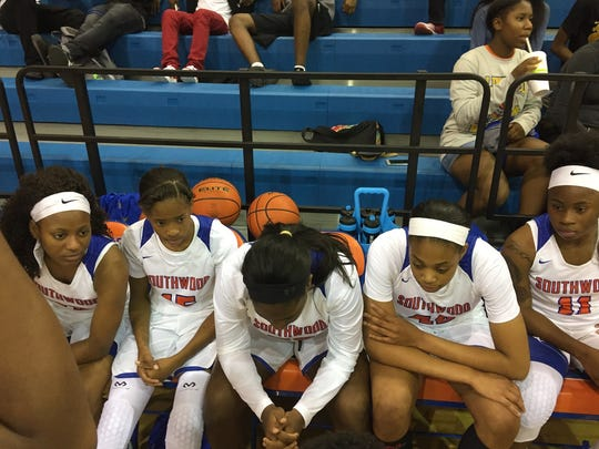 The Southwood girls listen to coach Stephen Harshaw prior to Tuesday's game with Bossier.