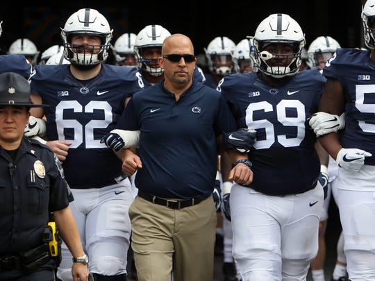 Penn State coach James Franklin leads his team to the