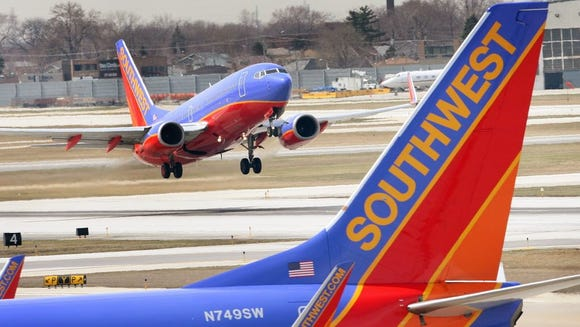 A Southwest Airlines jet takes off at Midway Airport