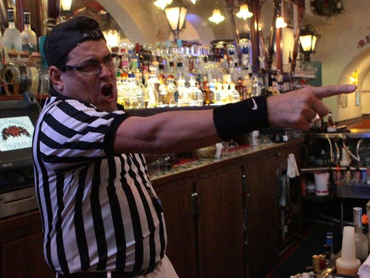 Las Casuelas Terraza bartender Hector Soliz blows his whistle and mimics referee calls at bar patrons during the first half of Super Bowl XLIX on Sunday, February 1, 2015 which the Palm Springs restaurant aired on several television screens. Soliz said he is an avid football fan, but only wears his referee outfit at the bar during the Super Bowl.