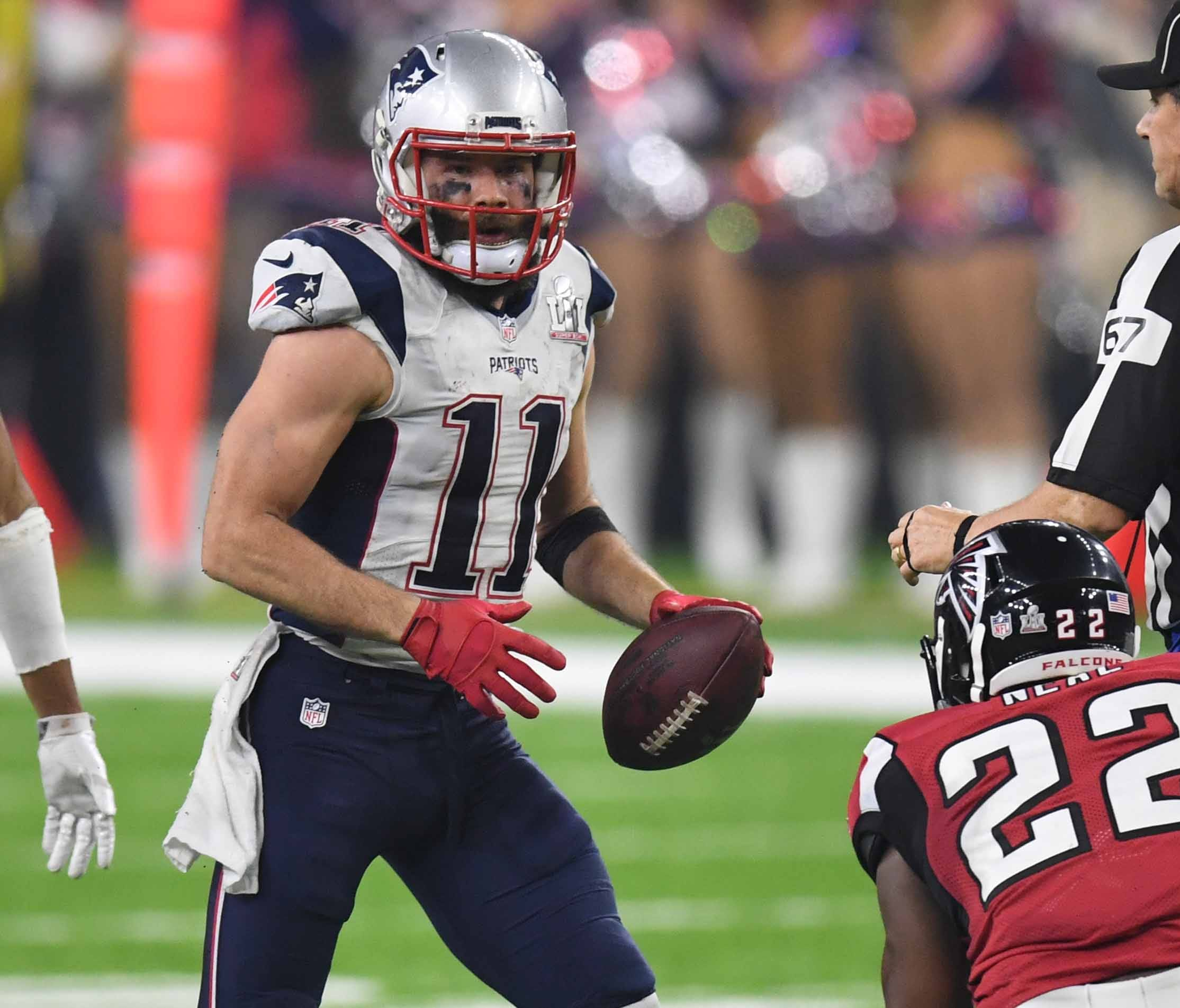 New England Patriots wide receiver Julian Edelman (11) makes a catch ahead of Atlanta Falcons strong safety Keanu Neal (22) during the fourth quarter during Super Bowl LI at NRG Stadium.
