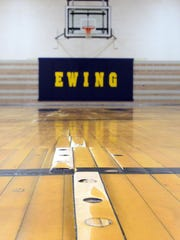 Pegs have been placed into some of slats in the gymnasium floor at Thomas Ewing Junior High School in Lancaster to minimize the unevenness of the floor. The floor is original to the building and is nearing the end of its life.
