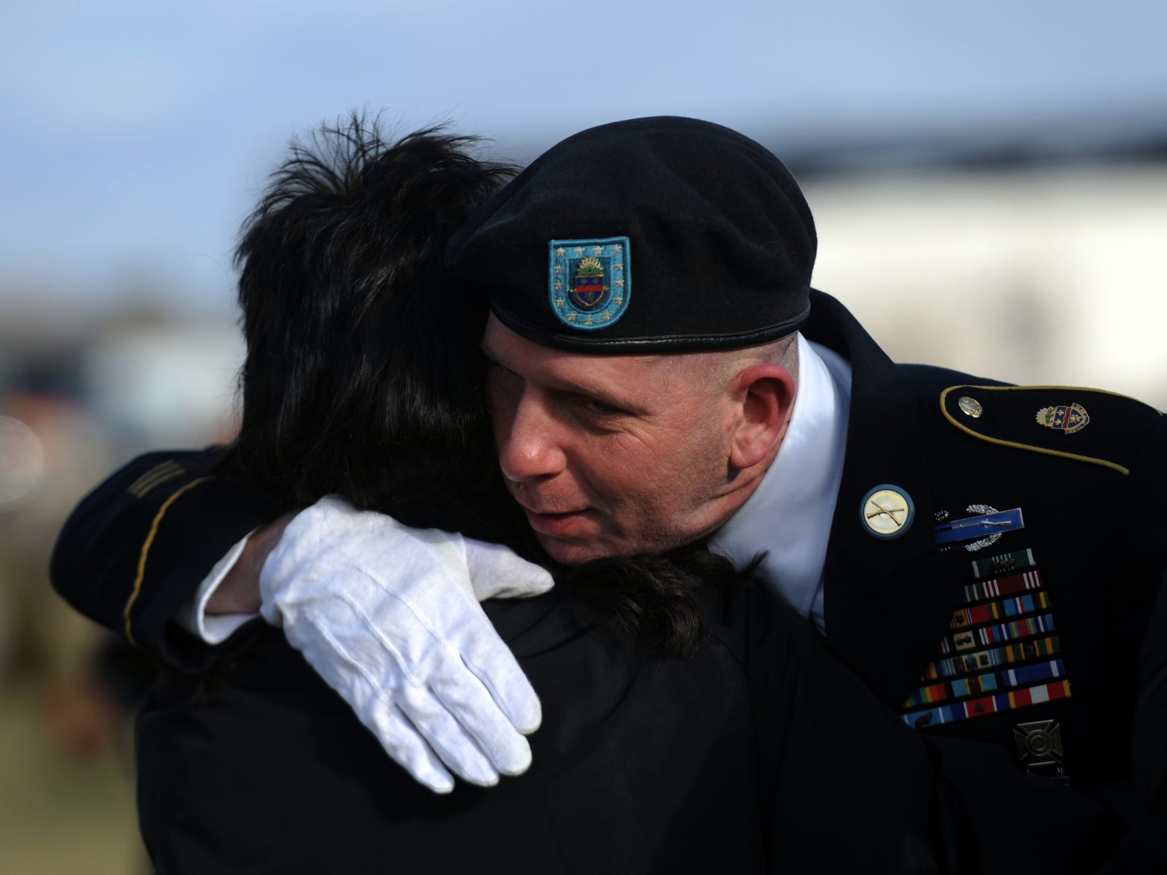 Jason Leasher hugs a funeral attendee Tuesday, Jan. 30, 2018, at Greenlawn Cemetery in Chillicothe. Leasher helped coordinate a graveside service for fellow veteran Mark Elkins after his body initially went unclaimed.