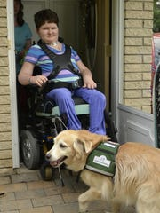 Erinne Williams with her service dog, Latte.