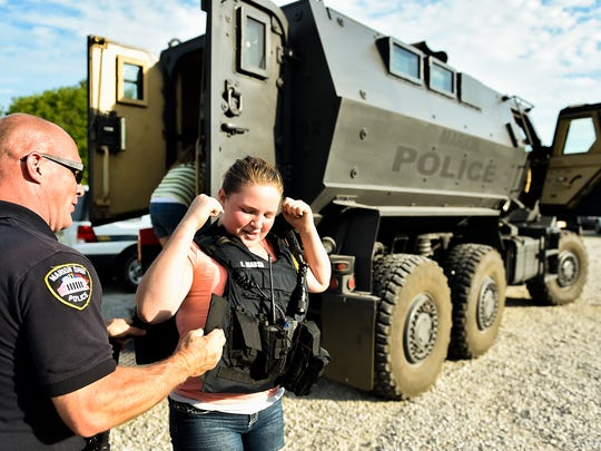 Eleven-year-old Jaidyn Maag gets help from Lt. Eric