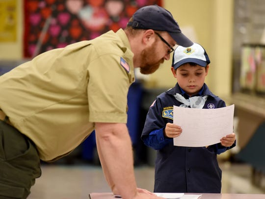 Joe Maldonado, the first openly transgender member of the Boy Scouts of America, looks at his Boy Scout application with Kyle Hackler, cub master of pack #20 of Maplewood/ South Orange, at his first meeting with his new troop.