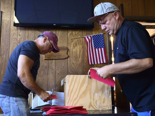 Election judges sort ballots as members of the IBEW