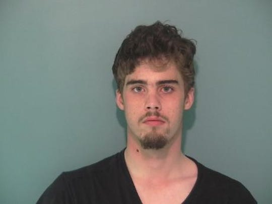 Seth Von Allmen, 18, in the Polk County Jail on charges of impersonating a peace officer, coercion and carrying a concealed weapon.
