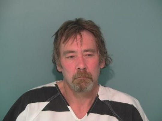 Kurt Von Allmen, 55, is in the Polk County Jail on charges of impersonating a peace officer and coercion.