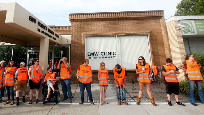 Volunteers line up to help clients enter the EMW Women's Surgical Center in Louisville on July 10, 2016. The abortion clinic's case against the administration of Kentucky Gov. Matt Bevin began Wednesday, Sept. 6, 2017.