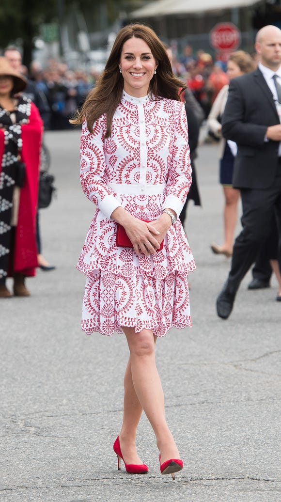 Kate toured Vancouver in red-and-white Alexander McQueen.