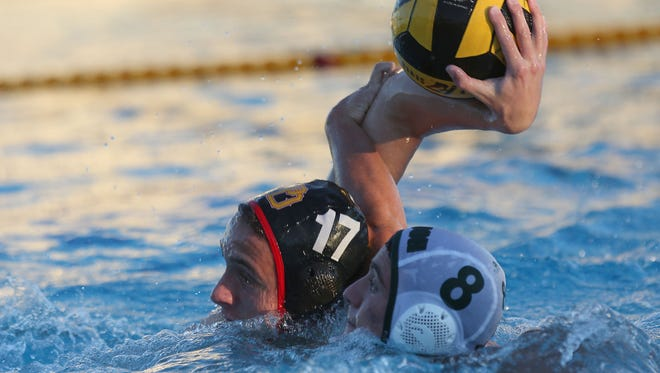 Kenny Pineo, 17, of Palm Desert is fouled by Trevor Case, 8, the Aztecs loss to Cajon, Tuesday, November 10, 2015.