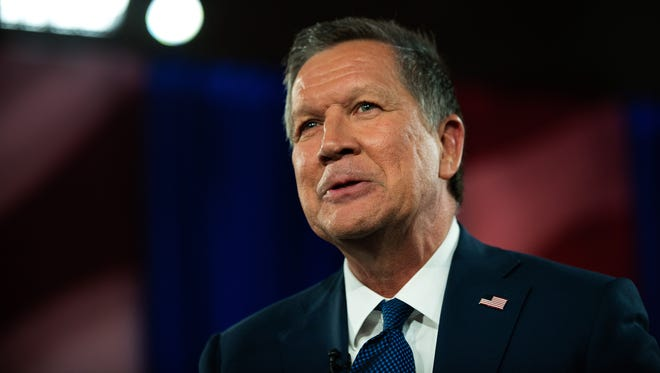 John Kasich speaks with the audience during a town hall meeting at St. Helen's Roman Catholic Church on March 30, 2016 in the Queens neighborhood of New York City.
