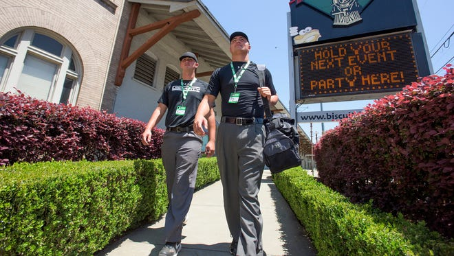 Austin Parker, left, and Trey Thompson take a lunch break as the Major League Baseball Umpire Camp makes a stop at Riverwalk Stadium in Montgomery, Ala., on Saturday May 14, 2016. The two drove to Montgomery from North Carolina to take part in the camp.
