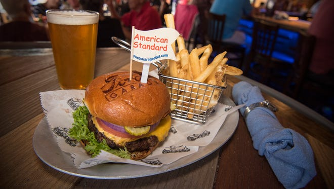 Ford's Garage, a car-themed restaurant specializing in craft burgers and beer, hopes to open a new University Town Center location by early May.