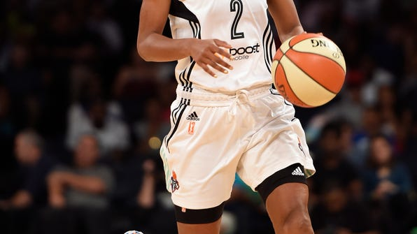 """FILE - In this July 16, 2015, file photo, New York Liberty guard Candice Wiggins brings the ball up during the team's WNBA basketball game against the Connecticut Sun in New York. Wiggins said her experience playing in the WNBA was """"toxic"""" and was a major reason why she retired last season. In an interview with The San Diego Union-Tribune, Wiggins said the culture in the league was """"very, very harmful"""" and that she was targeted throughout her career for being heterosexual and popular. (AP Photo/Kathy Kmonicek, File)"""