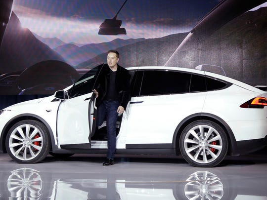 In this Sept. 2015 photo, Elon Musk, CEO of Tesla Motors Inc., introduces the Model X car at the company's headquarters in Fremont, Calif.