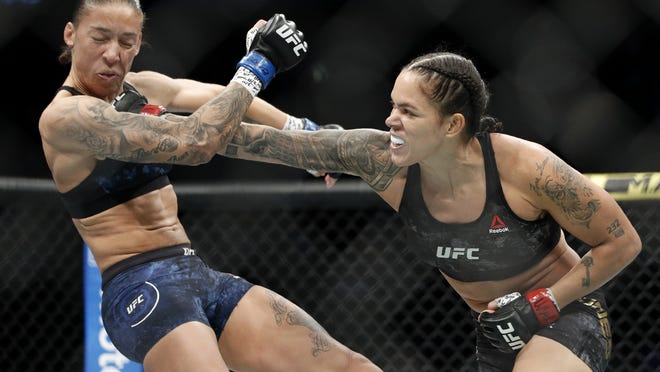 UFC fighter Amanda Nunes, right, will defend her featherweight title defense against contender Felicia Spencer in UFC 250 scheduled for Saturday.