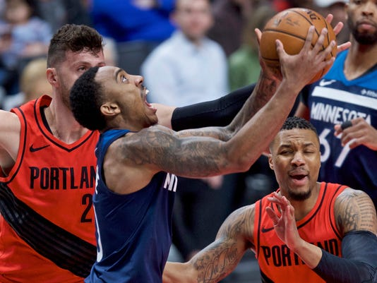 Minnesota Timberwolves guard Jeff Teague, center, shoots in front of Portland Trail Blazers guard Damian Lillard, right, and center Jusuf Nurkic, left, during the first half of an NBA basketball game in Portland, Ore., Thursday, March 1, 2018. (AP Photo/Craig Mitchelldyer)