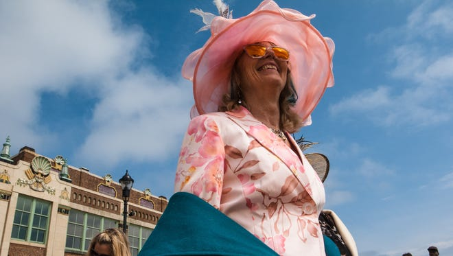 Parader Joy Hannan marches with smiles as spectators cheer, Sunday, March 27, 2016, in Asbury Park, New Jersey.
