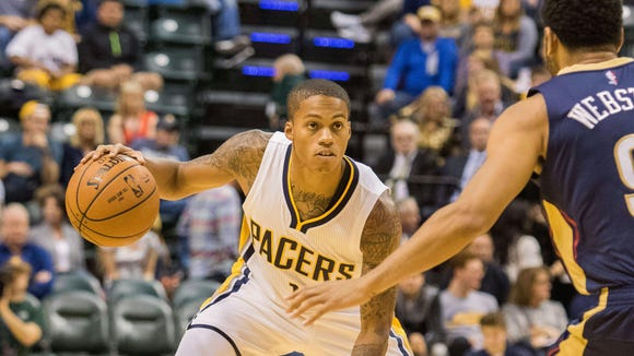 Oct 3, 2015; Indianapolis, IN, USA; Indiana Pacers guard Joseph Young (1) dribbles the ball  in the second half of the game against the New Orleans Pelicans at Bankers Life Fieldhouse. The Pelicans beat the Pacers, 110-105.  Mandatory Credit: Trevor Ruszkowski-USA TODAY Sports