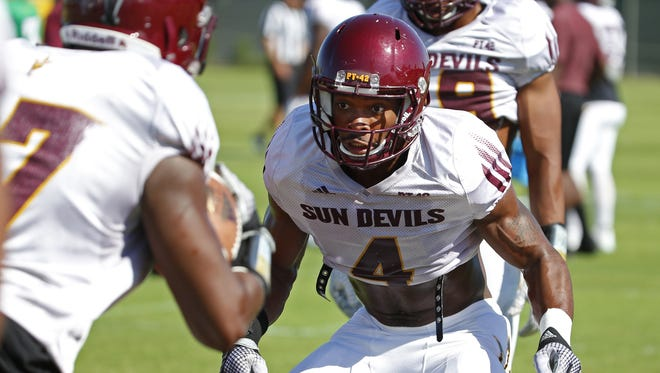 ASU's Koron Crump (4) tackles J'Marcus Rhodes (17) during an outdoor practice at ASU on August 15, 2016 in Tempe.