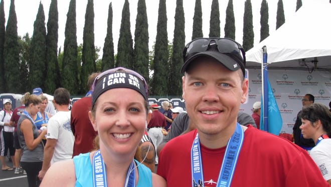 Craig (right) and Bobbi Skrynyk ran the Disneyland half-marathon in the quest to run 50 13.1-mile races before they're 50 years old. The pair will run their 69th half marathon at the American Bank Center Half Marathon on Saturday.