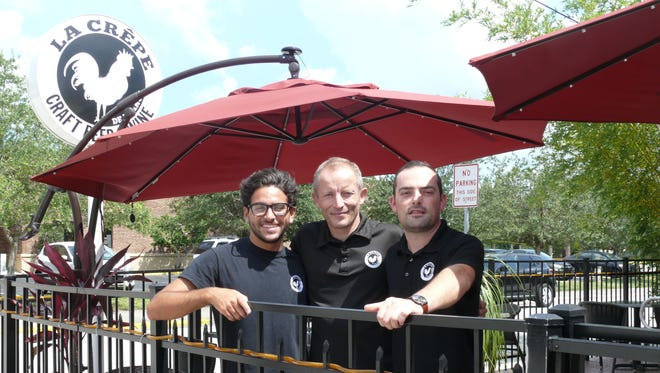 The management team for La Crepe de France in downtown Melbourne includes, from left, Zach Hobby, Gregory Marcot and Pierre Esbelin.