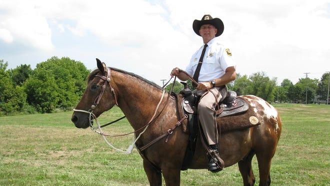 Sanilac County Sheriff Garry Biniecki is mounted on Spot.
