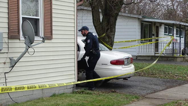 Agents with the MARMET Drug Task Force were still searching a home in the 300 block of Farming Street for drugs Thursday afternoon. Earlier in the day, a deputy shot himself in the foot while trying to ward off attacking dogs.