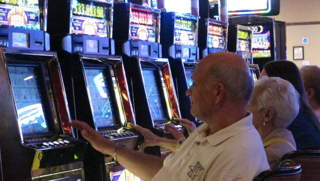 In this June 24, 2016 photo, gamblers play slot machines at the Golden Nugget casino in Atlantic City, N.J. Many York County municipalities have opted out of having a mini-casino located there.