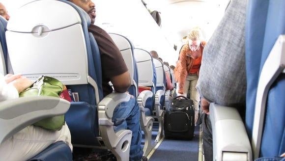 Passengers board a Delta Airlines flight.